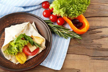 Veggie wrap filled with chicken and fresh vegetables