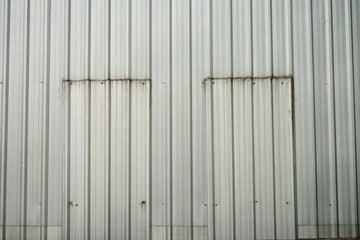 Old zinc wall with twin door