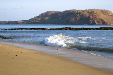 Beautiful wild beach ashore the Pacific ocean in Costa Rica