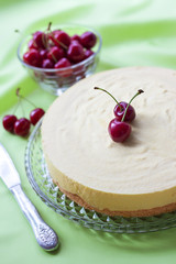 Milk souffle and white chocolate cake with fresh cherry