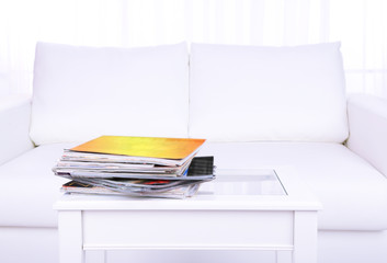 Magazines on coffee table in room