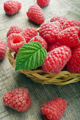 Heap of raspberry on a wooden background
