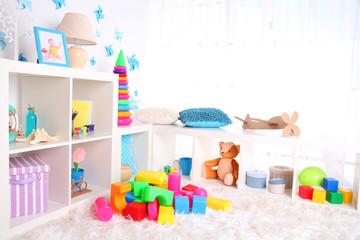 Colorful plastic toys in children room