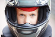 Portrait of young racer in helmet