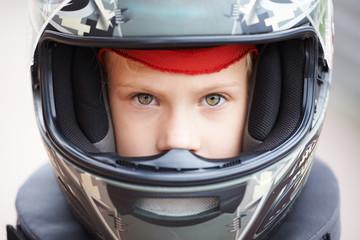 Portrait of young racer in helmet