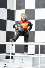 Happy little girl is winner on karting