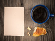 Croissant with coffee and a note paper