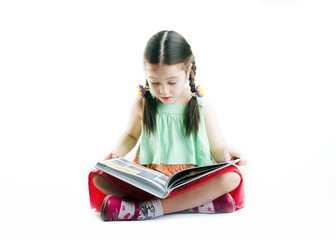 Small cute child reading a book