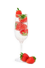 Elegant glass filled with mineral water with gas bubbles and jui