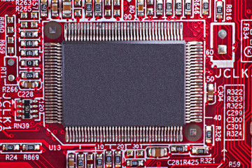 Red electronic circuit board with processor