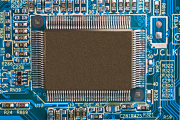 Blue electronic circuit board with processor