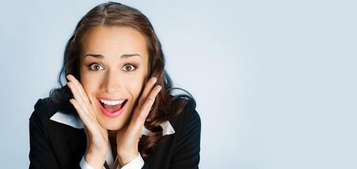 Surprised businesswoman, over blue