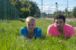 Two handsome young guys on the grass