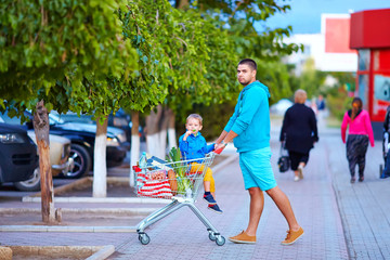 father and son after shopping in supermarket