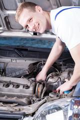 Mechanic checks a car engine