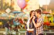 Leinwanddruck Bild - Young man in love feeding his girlfriend