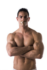Muscular young man with duct tape on mouth cannot speak