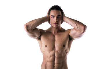 Muscular shirtless young man covering ears with hands