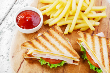 Grilled sandwich with ham cheese  french fries