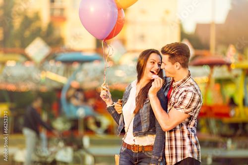 Leinwanddruck Bild Young man in love feeding his girlfriend