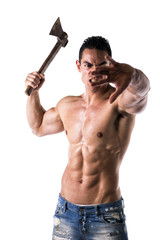 Aggressive, violent muscular young man with axe in his hand