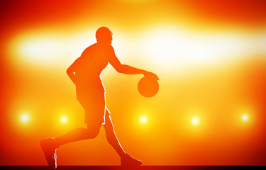 Basketball player silhouette dribbling with ball on red