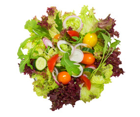 Fresh vegetable salad  isolated on white. Upper view.