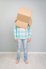 Man with cardboard box on his head
