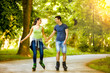 Smiling couple riding rollerblades