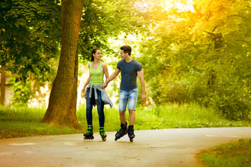 love couple ride rollerblades