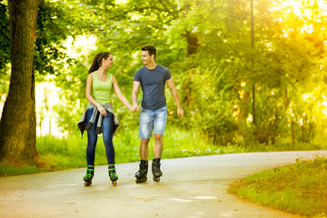Lovers in nature on rollerblades