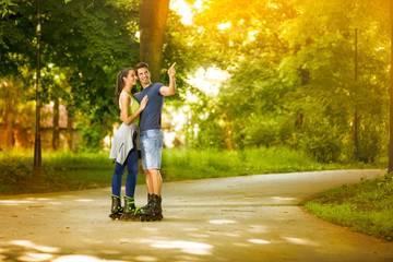 affectionate couple on rollerblades