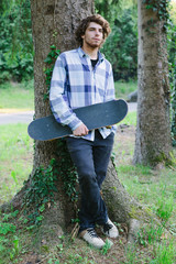 Teenage boy with skateboard.