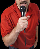 close up of man singing in microphone