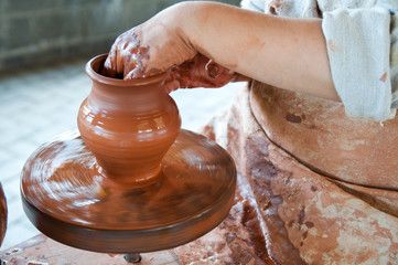 Potter making the pot in traditional style. Close up view
