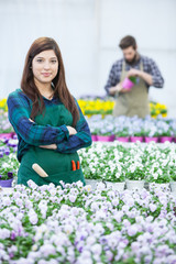 Young florist  in greenhouse