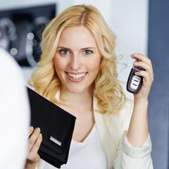Female customer gets her car in a garage