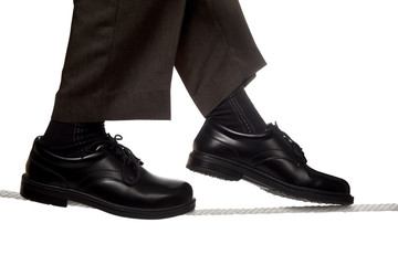 business man walking a tight rope