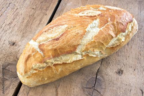 Fototapeta Homemade bread on wooden background
