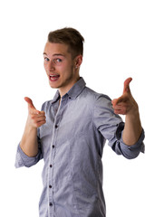Happy attractive young man pointing fingers at camera