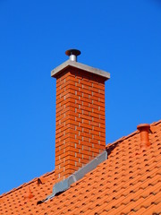 chimney in bright tile roof  with brick sunlight