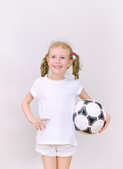 Little girl with ball smiling. Space for text.