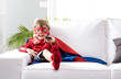 Superhero boy watching tv