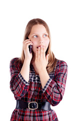Surprised teen girl talking on the mobile phone