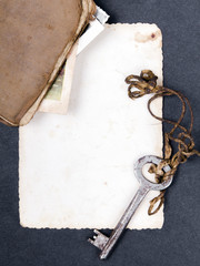Rusty key, old book and empty photography as a memory metaphor