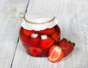 Strawberry jam in a glass jar