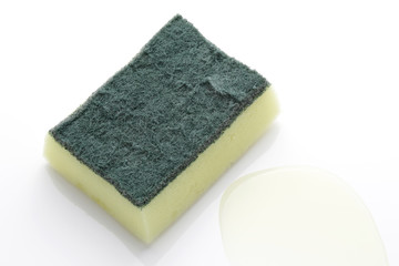 used scrubber pad with sponge and washing liquid