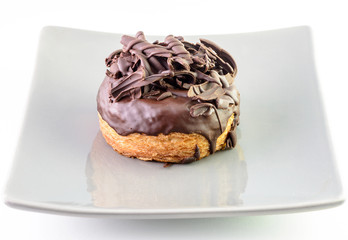 Boston cream chocolate donut isolate on dish