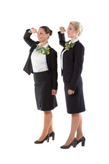 two flight attendants greet the crew commander