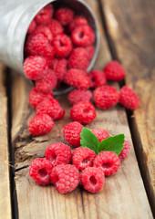 Ripe raspberries on a wooden